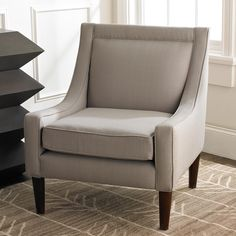 "Modern Sloped Arm Side Chair This trendy arm chair is as comfortable as it is fashionable; the simple design skillfully utilizes an uncomplicated silhouette with refined sloped arms and wooden legs, and the dove gray color complements a variety of stylish decor. (34""Hx29""Lx27""W)"