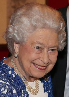 Queen Elizabeth beamed as she was seen in a dramatic blue and white lace applique gown as she greeted guests. She accessorized her outfit with a dazzling necklace of pearls and a stunning sapphire brooch, seemed in high spirits for the event.