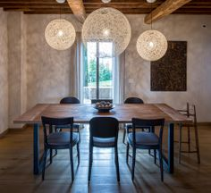 Dining table and chairs fit in perfectly in the Tuscan style. The lights from Moooi make a light contrast due to transparency.