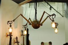 Four arm chandelier from Early Electrics     STEAMPUNK: The New Section at The Pier Antiques Show | VandM's DESIGNinTELL