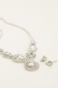 This high-shine pear and pave rhinestone necklace and earring set is a must-have for any evening look!   Necklace consists of high-shine pear shaped stones are accented by pave rhinestones.  Adjustable lobster clasp closure.  Earrings feature pear shaped stones.  Post backs.  Imported.
