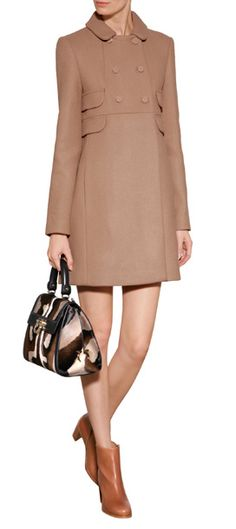 Imbued with a sixties silhouette, this Tara Jarmon wool coat adds feminine flair to your new-season look #Stylebop