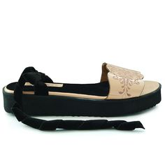 Flat sandals inspired by Islamic art. Made from natural leather and embellished…