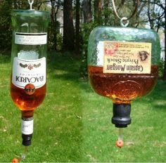 Cute hummingbird feeders made from recycled booze bottles. No that's not alcohol in the bottles..sugar water with yellow and a drop of brown to make it appear that they have alcohol still in them.