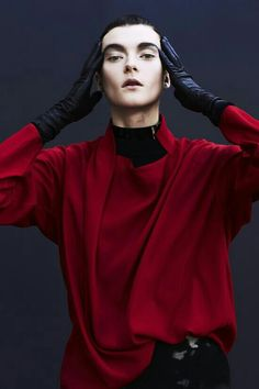 This is androgynous because of how the garment avoids contouring the chest, and the use of more feminine gestures and expressions to offset the masculine facial features.