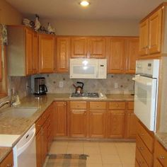 White Kitchen Oak Cabinets bright kitchen with oak cabinets, black granite counters, tile