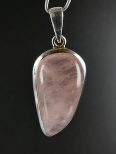 Beautiful good quality cabachon of Rose Quartz mounted in sterling silver This is unique item you get what is on the picture Free gift box included Setting silver Sterling silver Dimension mm 35 x 14 x 8 mm overall size including setting/bail Weight