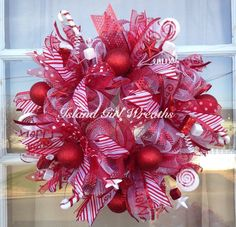 This beautiful red and white peppermint colors candy inspired handcrafted wreath is made on a white wreath from and is embellish with a candy cane, peppermint candy, 5 different types of ribbons, red and white ornaments, a merry Christmas sign. Christmas Mesh Wreaths, Deco Mesh Wreaths, Christmas Decorations, Holiday Decor, Merry Christmas Sign, Christmas Ideas, Xmas, Christmas Tree, White Wreath