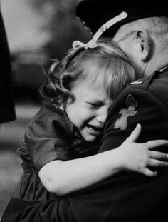 """An unknown lieutenant in the 32nd """"Red Arrow"""" Infantry Division gets a tearful goodbye hug from his daughter he prepares to leave with his unit for post mobilization training at Fort Lewis, WA during the Berlin Crisis of 1961."""