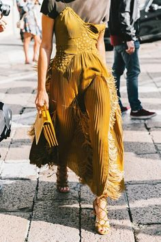 The mix and match dress trend is huge on street style stars right now. See how to wear the trend, and shop the pieces that our editors are loving