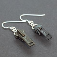 Found Object Jewelry- Upcycled Black Zipper Pull Earrings. $12.00, via Etsy.