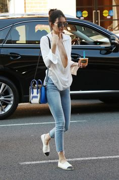 Kendall completed her look with a pair of skinny jeans, a Céline bag, Chanel espadrilles, and aviator sunglasses.