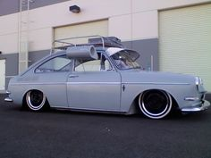 66 fastback vw. note the old air conditioner hanging from the car window