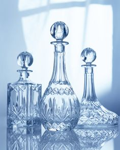 Crystal decanters-like the mix of shapes. Check some vintage places or de label old fashion bottles