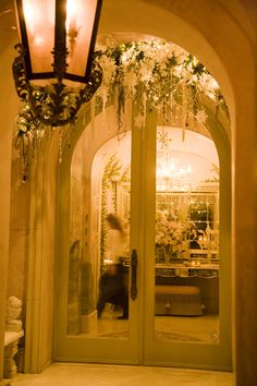 "Formal Entry way were guests entered into the home for the holiday party at our clients home in ""A Versaille Christmas in California"".      Took me almost four hours alone to finish the arch up over the door just in time for the party!    www.TresFabuEvents.com  Tres Fabu Event Planning and Design"