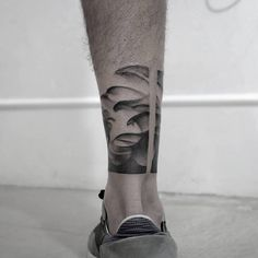 Abstract-dotwork ankle band tattoo.