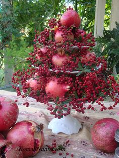 Pomegranates and berries from the garden make a stunning centerpiece