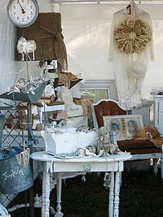 luckets outdoor  flea market..love the wreath over the ?clothing...would be a great way to display my crosses over the robe I wore when I was baptized.