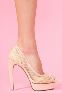 Gemma Platform Pump - Nude  Sky-high nude leather platform pumps featuring a sheer mesh upper and peep toe. Chunky platform and curved heel. Partial genuine leather lining, cushioned insole. Looks chic paired with a body-con dress and statement necklace! By Jeffrey Campbell.