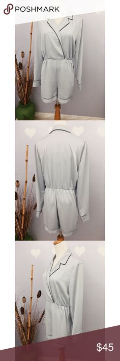 Missguided Silky Pyama Style with Black Piping NWT Missguided Silky Pyama Style with Black Piping Light Grey V Neck Romper NWT Sz 6 Brand new with tag.  100% polyester Elastic waist  Measurements laid flat Length: 31 Waist: 14.5 Pit to pit: 20.5 Sleeve: 23.5 Inseam: 3 1/4 Missguided Pants Jumpsuits & Rompers