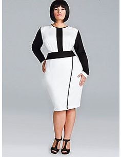 The Melanie Dress is a fresh take on the wrap style. This versatile dress features color-blocking, a faux wrap skirt, soft double knit ponte, and a full back zipper for ease of fit.  Pair this dress with a patent leather pump to finish the look. You are sure to turn heads and command attention in the Melanie Dress.    Model is wearing a 1X(14/16)  Dress Length: 42.5' from shoulder to hem  Faux Wrap Skirt  Full back zip  Polyester/Rayon blend (86% Poly/12% Rayon/2% Spandex)  Dry Clean Only…