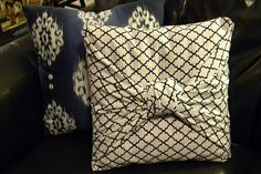 Create a no-sew pillow case for throw pillows by using a fabric that's thrice as big as the pillow. Place the pillow on the other side of the fabric and fold the upper and lower fabric to cover the pillow crosswise. Turn the pillow over and fold the two long sides into triangles. Knot together and tuck in the excess fabric.