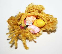 Miniature Handmade Easter Bird Nest $16 Adorable cute little bird nest. Bird and the eggs are sculpted from fimo. I used regular fimoo clay and also extra sparkling fimo. The nest fabric is the courtesy of my nana. Size is app. 3 x 3 x 2 cm / 1,1 x 1,1 x 0,7 inches Scale 1:12 Perfect for fairy gardenn, dollhouse or a room box display. Free shipping worldwide. For adult collection and display, unsuitable for children under 14 years, due to small parts. Garden Items, Miniature Fairy Gardens, Little Birds, Easter Eggs, Sculpting, Bird Nests, Miniatures, Clay, Handmade