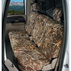 I don't care if it looks redneck I love max 4 camo seat covers. Plus they're neoprene so they stay cool in the summer and they're waterproof.