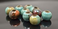 10 Mykonos Greek Ceramic Beads - 8mm Round Raku - Frosted Copper - 10 BEADS. $12.50, via Etsy.
