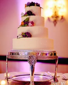Gorg #weddingcake with a subtle accent of purple #uplight #lighting from @RentMyWedding!