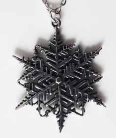 Intricate cut out pewter snowflake pendant. Snowflake Jewelry, Viking Warrior, Christmas Jewelry, Pendant Jewelry, Snowflakes, Hair Accessories, Pendants, Anastasia, Gifts
