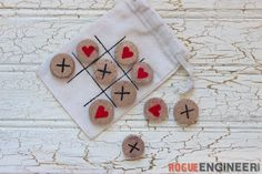 My kids love to play tic tac toe, and with Valentine'd Day right around the corner I wanted to make something cute that I knew they would love. It's no secret that I love a glass of wine... so with some extra corks laying around I was able to make this adorable game of tic tac toe to go!