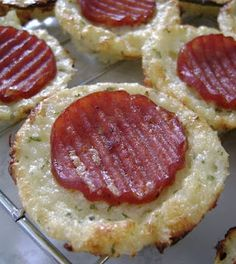 Cauliflower Pizza Bites.    Ingredients  2 cups grated cauliflower  1/4 cup egg whites  1 cup 1% Cottage Cheese  1 tsp oregano  2 tsp parsley  1/4 tsp garlic salt  pinch black pepper  pinch hot sauce  36 slices turkey pepperoni    Directions  Preheat oven to 450. Spray mini muffin trays with cooking spray.  In a hot frying pan, stir the grated caul