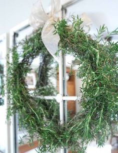 fresh rosemary wreath made with wire coat hanger. I'm making this soon because my rosemary needs serious trimming.