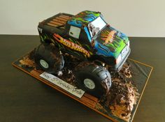 - Hot wheels monster truck, Hersheys choc cake, rkt tyres covered in fondant, edible paper flames cut out and adhered then coloured :)