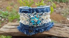 Check out this item in my Etsy shop https://www.etsy.com/listing/505589620/frayed-denim-cuff-with-crocheted-lace