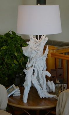 driftwood lamp painted white - much easier than bleaching. seen on The Elegant Thrifter