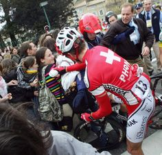 Gallery: Through the years at #ParisNice - Christian Prudhomme helps Martin Elmiger and the Paris-Nice peloton find a path through a student protest on the road to Rasteau in 2006.