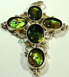 "Artisan Design, Lovely Cross Pendant, Sterling Silver, Hallmarked .925. Greenish Color Paua Shell Cab Stones. Cross features five oval 18x13mm stones. Bezel Set. Nice motif sterling silver setting. Cross measures approx. 3-1/8"" long x 2-3/8"" widest... Excellent condition. www.etsy.com/shop/SylCameoJewelsStore"