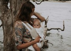 These carriers are ergonomically designed with your lifestyle in mind making transfers simple and breast feeding on the go a breeze. A modern take on the traditional Mei Tai style carrier. Baby Wraps, Earth Tones, Bohemian, Couple Photos, Baby Carriers, Sands, Couple Shots, Couple Photography, Boho