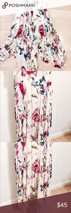 "NWOT! Free People floral  skirt NWOT! Beautiful floral skirt by Free People ! Brand new without tags! - Smocked waistband - Allover print - Handkerchief hem - Approx. 28"" shortest length, 36"" longest length Fiber Content: 100% rayon Free People Skirts"