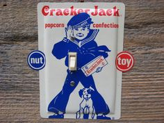 Light Switch Plate Cover From An Old Cracker Jack Sailor Bingo Dog Popcorn Tin Single Toggle Switchplates Kids Childrens Room Decor SP-0163 by tincansally on Etsy https://www.etsy.com/listing/180116548/light-switch-plate-cover-from-an-old