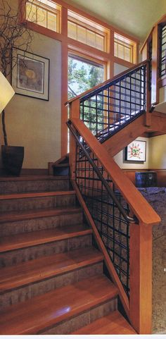 Stairs; Wrought iron handrail, wood and tile steps