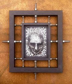 Compression of thoughts is a steel sculpture made by Scott Wilkes . This sculpture is made from hundreds of small steel rods welded together framed with steel tubing and threaded steel rods and nuts. This sculpture is a wall mount sculpture . This sculpture has a bit of a dark edge