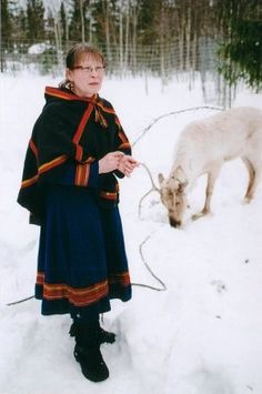 A Swedish Saami woman in traditional dress with a white reindeer. Photo by Anthony Randell. - The Saami - Reindeer People of the North by Carolyn Emerick