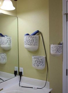 Mount plant holders in your bathroom to store hair styling supplies. Perfect for hair dryers, curling irons and brushes! Definitely helps you save a bit of cabinet space.