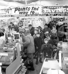Even before the last snowflake had fallen there is a general scramble for food, particularly break and milk, as shoppers crowd into a food store at 81st Street and Cicero Avenue in Chicago.