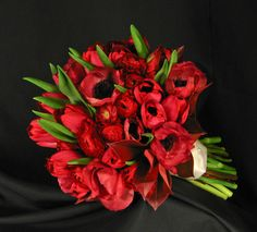 Stunning red anemone. red ranunculus and red tulip bouquet created at Simple Bouquets studio.