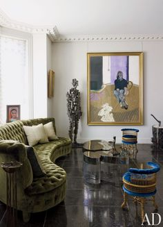 An Antony Gormley statue stands to the left of a Francis Bacon painting in a London sitting room by Jacques Grange. The custom-made sofa, one of a pair, is upholstered in silk velvet, the Cloud cocktail table is by Guy de Rougemont, and the faux-bamboo Napoléon III chairs are from the estate of Madeleine Castaing. DESIGNER: Jacques Grange PHOTOGRAPHER: Henry Bourne