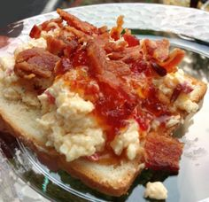 Minner cheese...12oz grated white cheddar, 4oz grated Parmesan, 4oz grated smoked Gouda, small jar diced pimentos with juice, 6TB Mayo, 2TB Jack Daniels, splash worchestershire, 1/2t chili powder, dash sugar, dash Cayenne, pinch of Cumin. Mix. Refrigerate. top with pepper jelly.